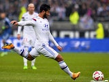 Lyon's French midfielder Nabil Fekir shoots the ball during the French L1 football match Lyon (OL) vs Guingamp (EAG) on November 9, 2014