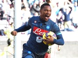 Jonathan De Guzman of Napoli celebrates after scoring the goal 2-2 during the Serie A match between SSC Napoli and Empoli FC at Stadio San Paolo on December 7, 2014