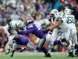 Geno Smith #7 of the New York Jets avoids a sack by Everson Griffen #97 and Tom Johnson #92 of the Minnesota Vikings during the second quarter of the game on December 7, 2014
