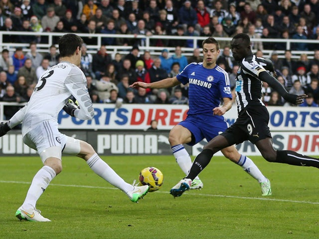 Newcastle United's Senegalese striker Papiss Cisse scores the opening goal past Chelsea's Belgian goalkeeper Thibaut Courtois during the English Premier League football match between Newcastle United and Chelsea at St James Park in Newcastle-Upon-Tyne, no