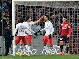 Paris Saint-Germain's Uruguayan forward Edinson Cavani celebrates after scoring a goal during their French L1 football match Lille vs PSG on December 3, 2014