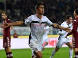 Paulo Dybala of Palermo celebrates after scoring his team's second goal during the Serie A match against Torino on December 6, 2014