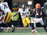 Le'Veon Bell #26 of the Pittsburgh Steelers attempts to run past Reggie Nelson #20 of the Cincinnati Bengals during the first quarter at Paul Brown Stadium on December 7, 2014