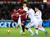 Eduardo Vargas of QPR takes Ashley Williams and Leon Britton of Swansea City during the Barclays Premier League match between Swansea City and Queens Park Rangers at Liberty Stadium on December 2, 2014