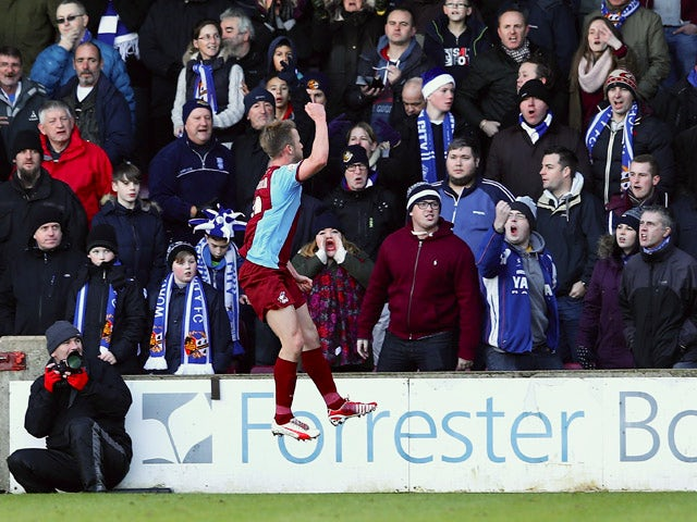 Paddy Madden of Scunthorpe United celebrates his goal during the FA Cup Second Round match between Scunthorpe United and Worcester City at Glanford Park on December 7, 2014