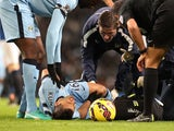 Manchester City's Argentinian striker Sergio Aguero lies injured during the English Premier League football match against Everton on December 6, 2014