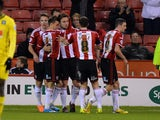 Jose Baxter of Sheffield United celebrateds scoring from the penalty spot during the FA Cup Second Round match between Sheffield United and Plymouth Argyle at Bramall Lane on December 6, 2014
