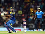 Sri Lankan cricketer Lahiru Thirimanne plays a shot during the fourth One Day International (ODI) match between Sri Lanka and England at the R. Premadasa Cricket Stadium in Colombo on December 7, 2014