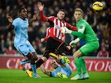 Connor Wickham of Sunderland scores the opening goal during the Barclays Premier League match between Sunderland and Manchester City at The Stadium of Light on December 3, 2014