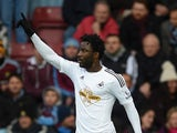 Wilfried Bony of Swansea City celebrates after scoring the opening goal during the Barclays Premier League match between West Ham United and Swansea City at Boleyn Ground on December 7, 2014