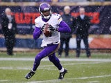 Teddy Bridgewater #5 of the Minnesota Vikings rolls out during the first half of a game against the Chicago Bears at Soldier Field on November 16, 2014