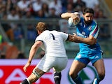 Tito Tebaldi of Italy is tackled by Chris Robshaw of England during the RBS Six Nations match between Italy and England at Stadio Olimpico on March 15, 2014