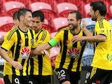 Wellington Pheonix team mates celebrate a goal during the round 10 A-League match between the Newcastle Jets and the Wellington Phoenix at Hunter Stadium on December 6, 2014