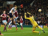 Craig Dawson of West Brom heads and scores the opening goal past Adrian of West Ham during the Barclays Premier League match between West Bromwich Albion and West Ham United at The Hawthorns on December 2, 2014