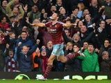 West Ham United's English striker Andy Carroll celebrates scoring their first goal to equalise during the English Premier League football match between West Ham United and Swansea City at the Boleyn Ground, Upton Park, in east London on December 7, 2014