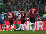 Wolfsburg's Belgian midfielder Kevin De Bruyne scores his team's opening goal during the German first division Bundesliga football match Hanover 96 vs VfL Wolfsburg in Hanover, central Germany on December 6, 2014