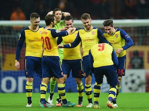 Arsenal through as runners up despite victory