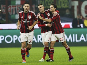 Giacomo Bonaventura of AC Milan celebrates his goal with his team-mate Jeremy Menez during the Serie A match between AC Milan and SSC Napoli at Stadio Giuseppe Meazza on December 14, 2014