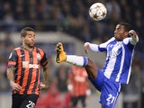 Shakhtar Donetsk's Brazilian midfielder Alex Teixeira (L) vies with Porto's forward Ricardo Pereira during the UEFA Champions League Group H football match on Decemnber 10, 2014