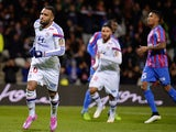 Lyon forward Alexandre Lacazette (L) celebrates with his teamates after scoring a penalty against Caen on December 12, 2014