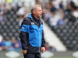 Ally McCoist, the Rangers manager, looks on during the pre season friendly match between Derby County and Rangers at iPro Stadium on August 2, 2014