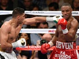 Amir Khan (L) throws a left at Devon Alexander in the eighth round of their welterweight bout at the MGM Grand Garden Arena on December 13, 2014
