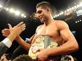 WBA super lightweight champion Amir Khan of England celebrates after defeating his challenger Marcos Maidana of Argentina on December 11, 2010