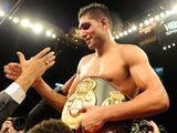 WBA super lightweight champion Amir Khan of England celebrates after defeating his challenger Marcos Maidana of Argentina on December 11, 2010