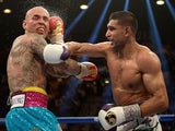 Amir Khan connects with a right at Luis Collazo during their welterweight bout at the MGM Grand Garden Arena on May 3, 2014
