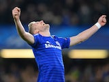 Chelsea's German striker Andre Schurrle celebrates scoring his team's second goal during the UEFA Champions League group G football match at Stamford Bridge in London on December 10, 2014