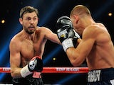 Andy Lee (L) and Matt Korobov battle during their fight for a vacant WBO middleweight title at The Chelsea at The Cosmopolitan of Las Vegas on December 13, 2014