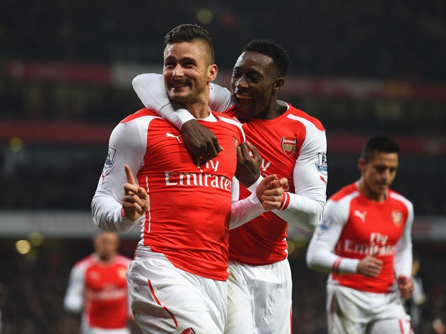 Olivier Giroud of Arsenal celebrates scoring his team's third goal with Danny Welbeck during the Barclays Premier League match between Arsenal and Newcastle United at Emirates Stadium on December 13, 2014