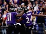 Wide receiver Kamar Aiken #11 of the Baltimore Ravens celebrates with free safety Darian Stewart #24 and linebacker Zach Orr #54 after scoring a first quarter touchdown off a blocked punt against the Jacksonville Jaguars at M&T Bank Stadium on December 14