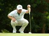 Branden Grace of South Africa putts on the 17th green during the second round of the Alfred Dunhill Championship at Leopard Creek Country Golf Club on December 12, 2014