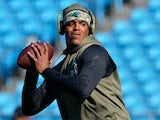 Cam Newton #1 of the Carolina Panthers warms up before the game against the Atlanta Falcons at Bank of America Stadium on November 16, 2014
