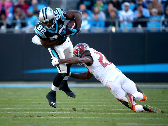 Jerricho Cotchery #82 of the Carolina Panthers lunges for more yardage in the 2nd half against the Tampa Bay Buccaneers during their game at Bank of America Stadium on December 14, 2014