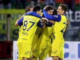 Riccardo Meggiorini of Chievo celebrated the goal 0-1 with the team-mates during the Serie A match between Cagliari Calcio and AC Chievo Verona at Stadio Sant'Elia on December 8, 2014