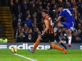 Diego Costa of Chelsea shoots past Alex Bruce of Hull City to score their second goal during the Barclays Premier League match between Chelsea and Hull City at Stamford Bridge on December 13, 2014