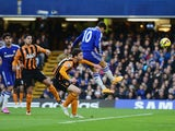 Eden Hazard of Chelsea (10) scores their first goal with a header during the Barclays Premier League match between Chelsea and Hull City at Stamford Bridge on December 13, 2014