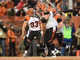 Rex Burkhead #33 of the Cincinnati Bengals celebrates his touchdown with Mike Pollak #67 during the fourth quarter against the Cleveland Browns at FirstEnergy Stadium on December 14, 2014