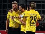 Dortmund's Italian striker Ciro Immobile (L) celebrates scoring with his team-mates during the second leg UEFA Champions League Group D football match against Anderlecht on December 9, 2014