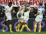 Damien Chouly of Clermont Auvergne is congratulated by teams mates after scoring his second try during the European Rugby Champions Cup pool one match between ASM Clermont Auvergne and Munster at Stade Marcel Michelin on December 14, 2014