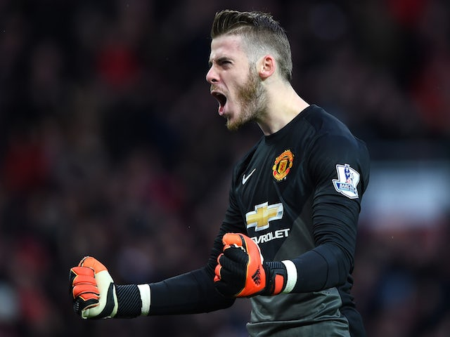 David De Gea of Manchester United celebrates the first goal during the Barclays Premier League match against Liverpool on December 14, 2014