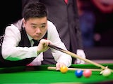 China's Ding Junhui plays a shot during his first round match against England's Shaun Murphy on day three of the Masters Snooker tournament at Alexandra Palace in London on January 14, 2014
