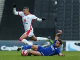 Georg Margreitter of Chesterfield clears the ball from Dele Alli of MK Dons during the FA Cup Second Round match between MK Dons and Chesterfield at Stadium mk on December 6, 2014