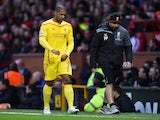 Glen Johnson of Liverpool goes off after sustaining an injury during the Barclays Premier League match against Manchester United on December 14, 2014