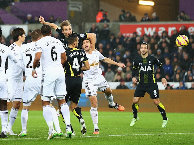 Harry Kane of Tottenham Hotspur heads the opening goal during the Barclays Premier League match against Swansea City on December 14, 2014