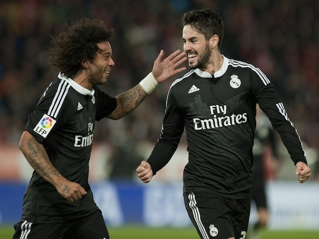 Real Madrid's forward Isco (R) celebrates with Brazilian defender Marcelo after scoring during the Spanish league football match UD Almeria vs Real Madrid CF on December 12, 2014