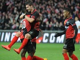 Guingamp's French forward Jeremy Pied (M) celebrates with teammates after scoring during the French L1 football match between EA Guingamp and Paris Saint-Germain (PSG), on December 14, 2014