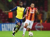 Joel Campbell of Arsenal battles with Felipe Melo of Galatasaray during the UEFA Champions League Group D match on December 9, 2014